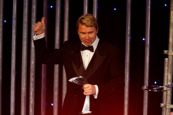 Grosvenor House Hotel, Park Lane, London 7th December 2008. Mika Hakkinen presents the International Racing Driver of the Year Award to Lewis Hamilton. Portrait.World Copyright: Glenn Dunbar/LAT Photographic ref: Digtal Image _O9T6977