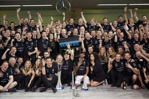 Yas Marina Circuit, Abu Dhabi, United Arab Emirates. Sunday 26 November 2017. Toto Wolff, Executive Director (Business), Mercedes AMG, Valtteri Bottas, Mercedes AMG, 1st Position, his wife Emelia, Lewis Hamilton, Mercedes AMG, 2nd Position, and the Mercedes team celebrate a great race result and another highly successful season. World Copyright: Steve Etherington/LAT Images  ref: Digital Image SNE13476