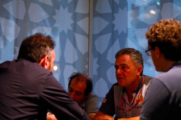 Yas Marina Circuit, Abu Dhabi, United Arab Emirates. Wednesday 29 November 2017. Mario Isola, Racing Manager, Pirelli Motorsport, talks to reporters, including Roberto Chinchero. World Copyright: Joe Portlock/LAT Images  ref: Digital Image _L5R1238