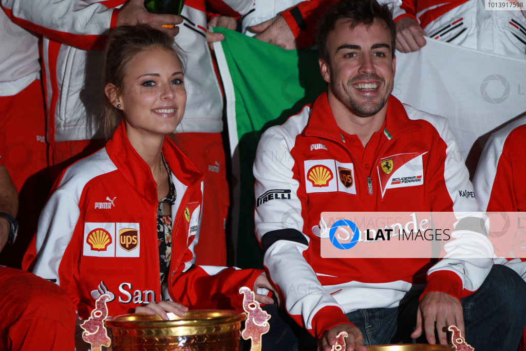 Shanghai International Circuit, Shanghai, China Sunday 14th April 2013 Fernando Alonso, Ferrari, 1st position, celebrates with girlfriend Dasha Kapustina and his team. World Copyright: Andy Hone/LAT Photographic ref: Digital Image HONY7150