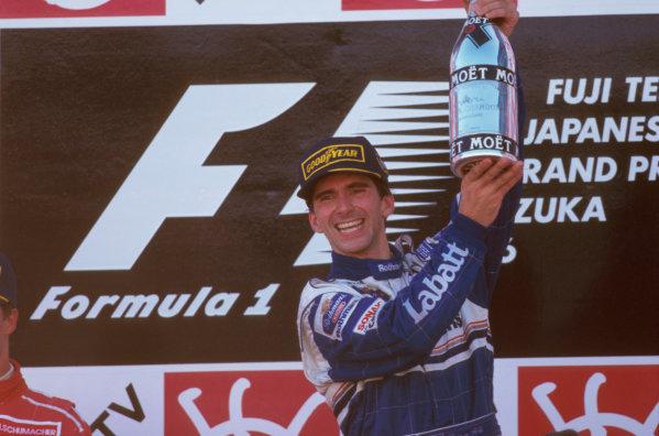 Suzuka, Japan.11-13 October 1996.Damon Hill (Williams Renault) 1st position, celebrates being the new World Champion on the podium. Ref-96 JAP 12.World Copyright - LAT Photographic