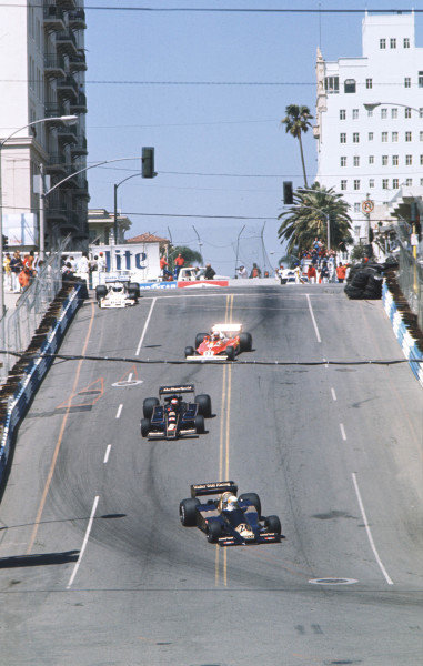 1977 United States Grand Prix West.Long Beach, California, USA.1-3 April 1977.Jody Scheckter (Wolf WR1 Ford) leads Mario Andretti (Lotus 78 Ford) and Niki Lauda (Ferrari 312T2).World Copyright - LAT Photographic