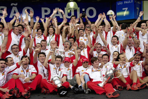 The cheering Ferrari team poses for the 2007 World Champion group photo.