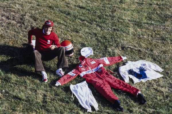 Niki Lauda displays his racing overalls and fireproofs.