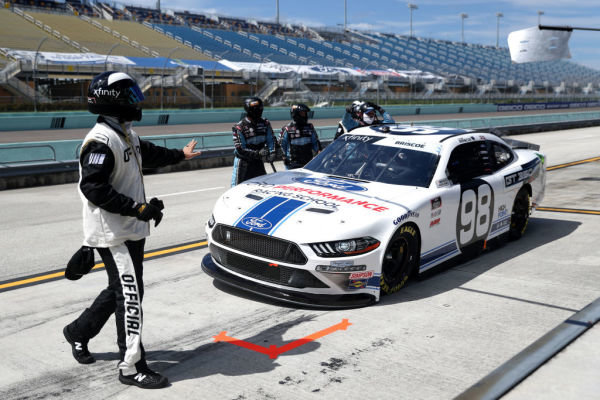 An official inspect, Chase Briscoe, Stewart-Haas Racing Ford Ford Performance Racing School, Copyright: Chris Graythen/Getty Images.