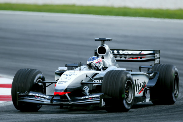 2003 Malaysian Grand Prix. Sepang, Kuala Lumpur, Malaysia.21-23 March 2003.Kimi Raikkonen (McLaren MP4/17D Mercedes) 1st position.World Copyright - LAT Photographic ref: Digital Image Only