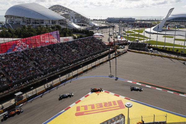 Lewis Hamilton, Mercedes AMG F1 W10, Carlos Sainz Jr., McLaren MCL34 and Valtteri Bottas, Mercedes AMG W10 and Lando Norris, McLaren MCL34