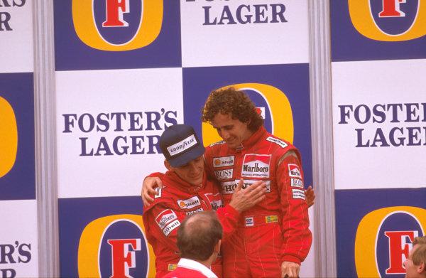 Adelaide, Australia.11-13 November 1988.Ayrton Senna congratulates Alain Prost (both McLaren Honda) on the podium, with Ron Dennis looking on.Ref-88 AUS 04.World Copyright - LAT Photographic