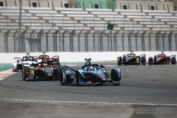 Tom Blomqvist (GBR), NIO 333, NIO 333 001, leads Jean-Eric Vergne (FRA), DS Techeetah, DS E-Tense FE21, Andre Lotterer (DEU), Tag Heuer Porsche, Porsche 99X Electric, and Oliver Rowland (GBR), Nissan e.Dams, Nissan IMO2