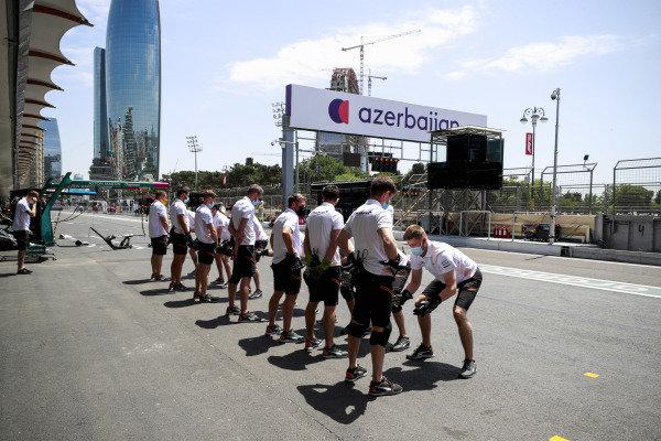 McLaren pit crew warm up