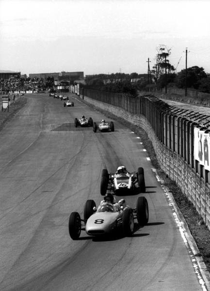 Dan Gurney (USA) Porsche 804, who slipped back with clutch trouble to finish ninth, leads third place finisher Bruce McLaren (NZL) Cooper T60. British Grand Prix, Aintree, 21 July 1962.