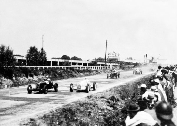 "1934 French Grand Prix Montlhery, France. 1 July 1934 Louis Chiron, Alfa Romeo Tipo-B ""P3"", 1st position, leads Rudolf Caracciola, Mercedes-Benz W25A, retired, and Achille Varzi, Alfa Romeo Tipo-B ""P3"", 2nd position, at the start, action World Copyright: Robert Fellowes/LAT PhotographicRef: 34FRA03"