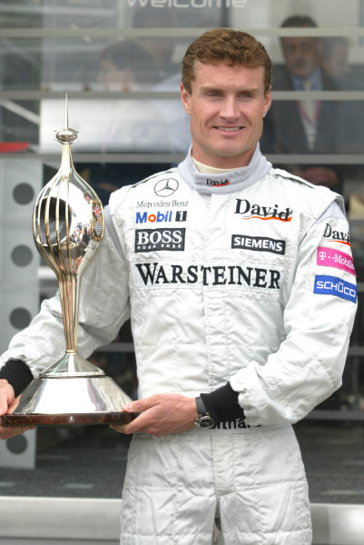 2004 British Grand Prix-Sunday Race, Silverstone, England. 11th July 2004. David Coulthard, McLaren Mercedes MP4/19B, winner of the Hawthorn Trophy. World Copyright LAT Photographic. Digital Image only (a high res version is available on request).