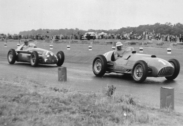 1951 British Grand Prix.Silverstone, Great Britain. 14 July 1951.Alberto Ascari (Ferrari 375) leads Giuseppe Farina (Alfa Romeo 159). Ref-C29862.World Copyright - LAT Photographic