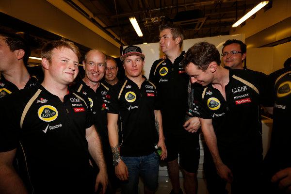Yas Marina Circuit, Abu Dhabi, United Arab Emirates Sunday 4th November 2012. Kimi Raikkonen, Lotus GP, celebrates victory with his team. World Copyright: Andrew Ferraro/  ref: Digital Image _79P4131