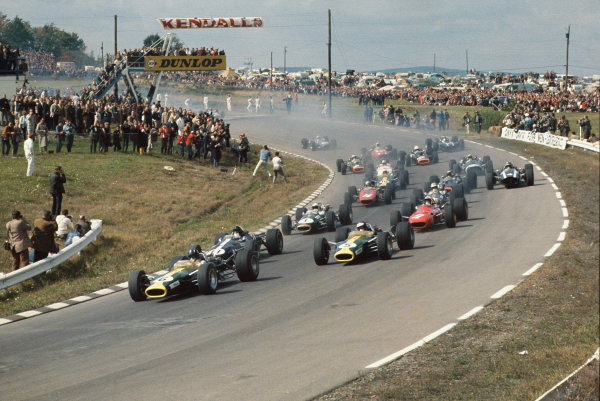 Watkins Glen, New York, USA. 30/9-1/10 1967. .At the start Graham Hill (Lotus 49 Ford) leads from Dan Gurney (Eagle T1G Weslake), Jim Clark (Lotus 49 Ford), Chris Amon (Ferrari 312), Jack Brabham and Denny Hulme (Brabham BT24-Repco), Bruce McLaren (McLaren M5A BRM), Jackie Stewart, Jochen Rindt, Moises Solana, Jo Siffert, John Surtees, Mike Spence, Chris Irwin, Jo Bonnier, Jacky Ickx, Guy Ligier and Jean-Pierre Beltoise.  Ref: 67USA33. World Copyright: LAT Photographic