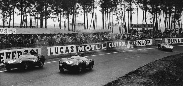 Le Mans, France. 28th - 29th July 1956.Paul Frere/Desmond Titterington (Jaguar D-type), retired, leads Jack Fairman/Ken Wharton (Jaguar D-type), retired, as they pass a spinning Alfonso de Portago/Duncan Hamilton (Ferrari 625 LM), retired, action. World Copyright: LAT Photographic.Ref: B/W Print.