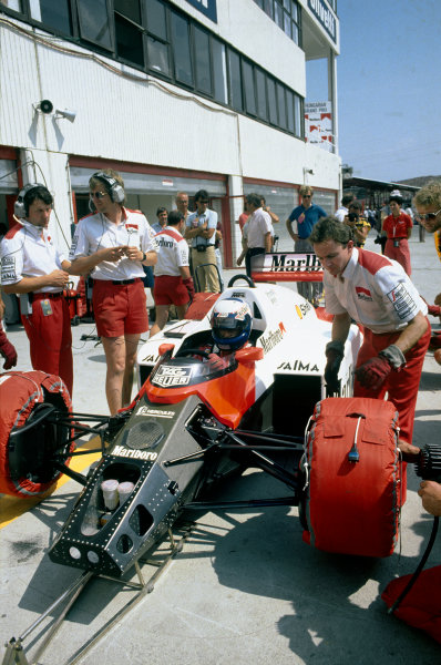 Hungaroring, Budapest, Hungary. 8-10 August 1986. Alain Prost (McLaren MP4/2C TAG Porsche), retired, in the pits with tyre warmers on, portrait. World Copyright: LAT Photographic.Ref:  Colour Transparency.