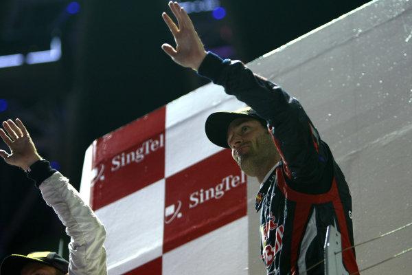Marina Bay Circuit, Singapore.25th September 2011.Mark Webber, Red Bull Racing RB7 Renault, 3rd position, arrives on the podium. Portrait. Podium. World Copyright: Andy Hone/LAT Photographicref: Digital Image CSP28799