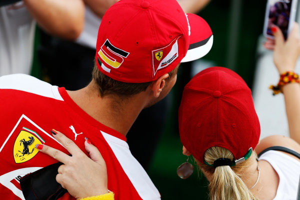 Hungaroring, Budapest, Hungary. Thursday 23 July 2015. Sebastian Vettel, Ferrari, with a fan. World Copyright: Charles Coates/LAT Photographic ref: Digital Image _J5R0800