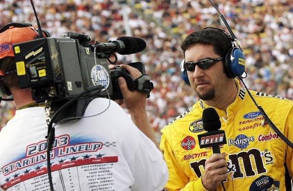 Fifth placed Elliott Sadler (USA) Robert Yates Racing M&M's Ford is interviewed prior to qualifying.NASCAR Nextel Cup Series, Rd 15, DHL 400, Michigan International Speedway, Brooklyn, Michigan, USA, 20 June 2004.DIGITAL IMAGE
