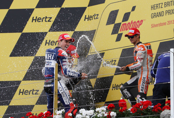 British Grand Prix.  Silverstone, England. 30th August - 1st September 2013.  Jorge Lorenzo, Yamaha, Marc Marquez and Dani Pedrosa, Honda, celebrate on the podium.  Ref: IMG_2527a. World copyright: Kevin Wood/LAT Photographic