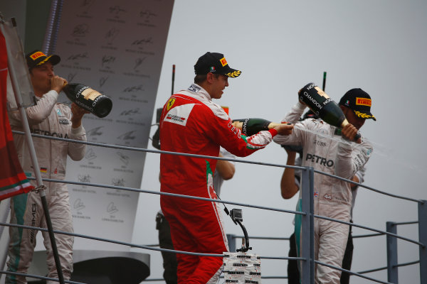 Autodromo Nazionale di Monza, Italy. Sunday 4 September 2016. Nico Rosberg, Mercedes AMG, 1st Position, Sebastian Vettel, Ferrari, 3rd Position, and Lewis Hamilton, Mercedes AMG, 2nd Position, celebrate with Champagne on the podium. World Copyright: Andy Hone/LAT Photographic ref: Digital Image _ONZ6982