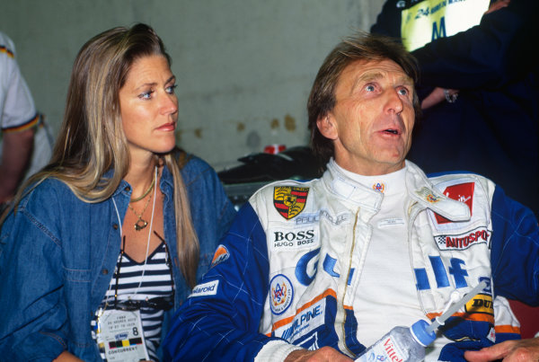 1994 Le Mans 24 Hours. Le Mans, France. 18th - 19th June 1994. Derek Bell with his wife Misty (Kremer Porsche Spyder), 6th position, in the pits, portrait.  World Copyright: LAT Photographic. Ref:  94LM26