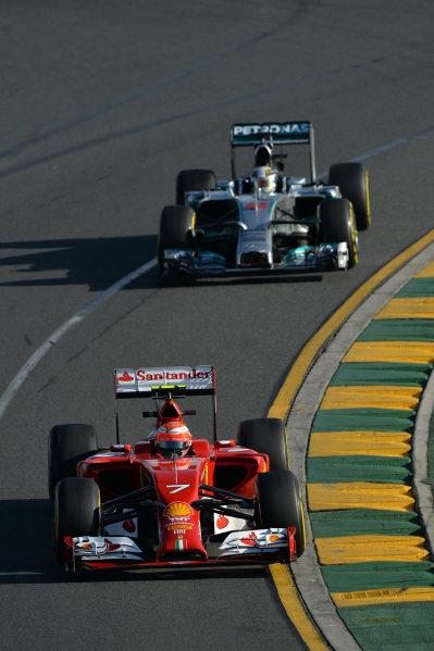 Kimi Raikkonen (FIN) Ferrari F14 T and Lewis Hamilton (GBR) Mercedes AMG F1 W05.Formula One World Championship, Rd1, Australian Grand Prix, Practice, Albert Park, Melbourne, Australia, Friday 14 March 2014.