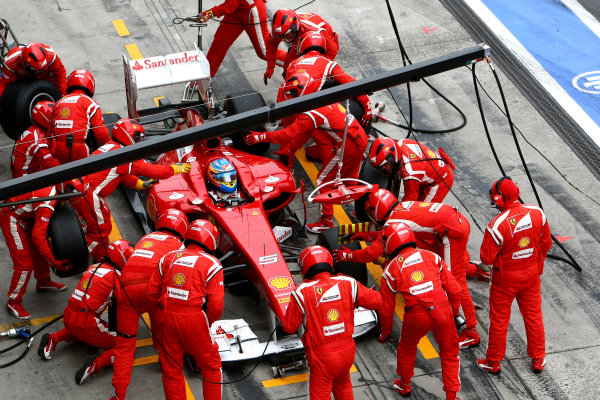 Nurburgring, Germany.24th July 2011Fernando Alonso, Ferrari 150° Italia, 2nd position, makes a stop. Action. Pit Stops. World Copyright: Andy Hone/LAT Photographicref: Digital Image CSP23881