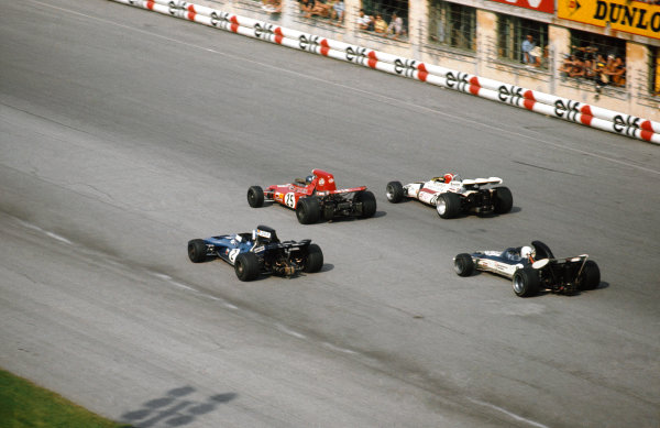 Monza, Italy. 3 - 5 September 1971.Ronnie Peterson (March 711-Ford), 2nd position, leads Jo Siffert (B.R M P160), 9th position, Francois Cevert (Tyrrell 002-Ford), 3rd position and Mike Hailwood (Surtees TS9-Ford), 4th position.  Ref: 71ITA66. World Copyright: LAT Photographic.
