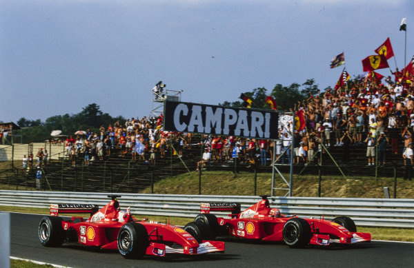 Rubens Barrichello, Ferrari F2001, celebrates with Michael Schumacher, Ferrari F2001.