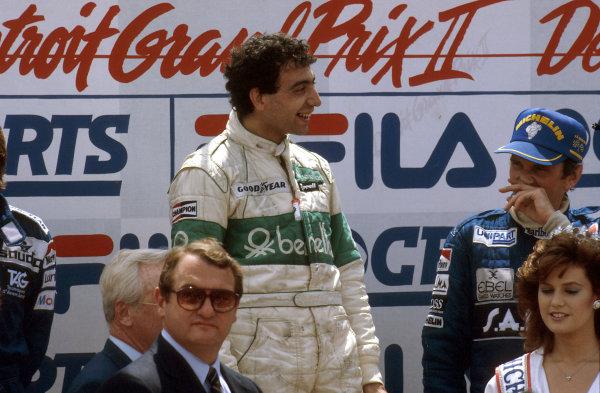 1983 United States Grand Prix East.Detroit, Michigan, USA.3-5 June 1983.Michele Alboreto (Tyrrell Ford) 1st position, John Watson (McLaren Ford) 3rd position on the podium.Ref-83 USA 04.World Copyright - LAT Photographic
