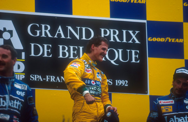 1992 Belgian Grand Prix.Spa-Francorchamps, Belgium.28-30 August 1992.Michael Schumacher (Benetton Ford) celebrates 1st position and his maiden Grand Prix win on the podium. Nigel Mansell, 2nd position and teammate Riccardo Patrese, 3rd position (both Williams Renault) also on the podium. 