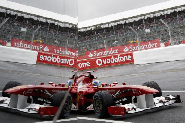 Fernando Alonso, Ferrari 150° Italia, reflected in the Wing pit building.