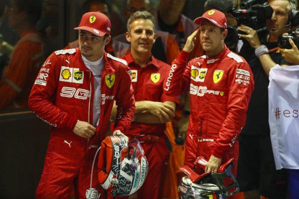 Charles Leclerc, Ferrari, 2nd position, and Sebastian Vettel, Ferrari, 1st position, in Parc Ferme