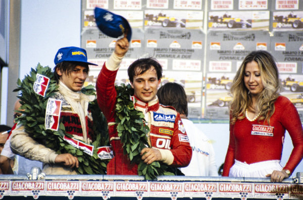 Beppe Gabbiani, 3rd position, and Corrado Fabi, 1st position, on the podium.