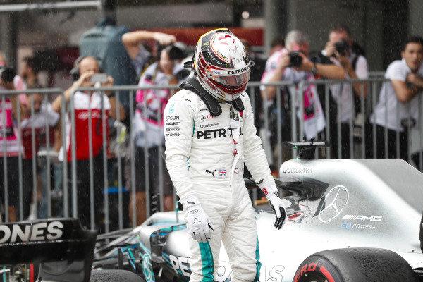 Lewis Hamilton, Mercedes AMG F1, celebrates pole position in parc ferme.