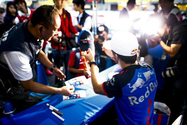 Pierre Gasly, Scuderia Toro Rosso, signs an autograph
