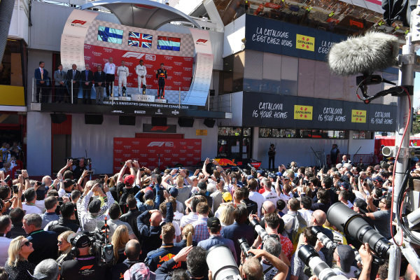 Dr Dieter Zetsche, CEO, Mercedes Benz Valtteri Bottas, Mercedes AMG F1, 2nd position, Lewis Hamilton, Mercedes AMG F1, 1st position, and Max Verstappen, Red Bull Racing, 3rd position, on the podium