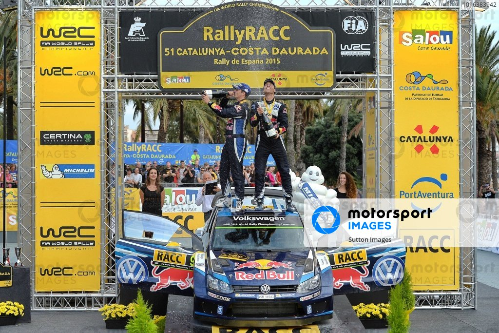 Race winner Andreas Mikkelsen (NOR) / Ola Floene (NOR) Volkswagen Polo R WRC celebrate on the podium at FIA World Rally Championship, Rd12, RAAC Rally de Espana, Day Three, Costa Daurada, Catalunya, Spain, 25 October 2015.