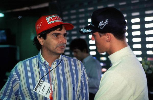 1995 Brazilian Grand Prix.Interlagos, Sao Paulo, Brazil.24-26 March 1995.Nelson Piquet talks to Michael Schumacher.Ref-P2A 01.World Copyright - LAT Photographic