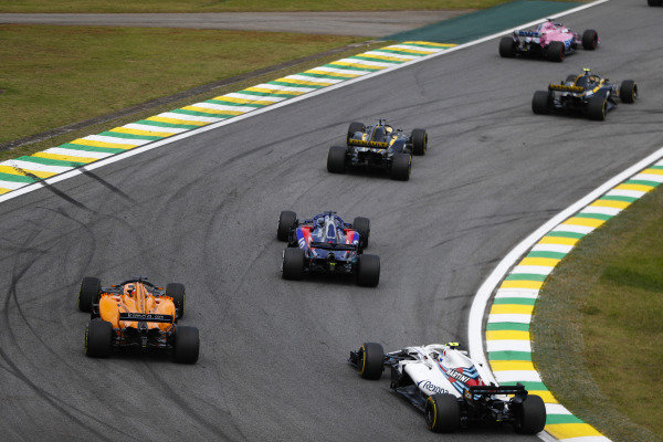 Sergey Sirotkin, Williams FW41 Mercedes, chases Fernando Alonso, McLaren MCL33 Renault, and Brendon Hartley, Toro Rosso STR13 Honda.