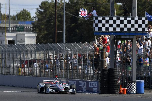 Will Power, Team Penske Chevrolet crosses the finish line under the checkered flag for the win