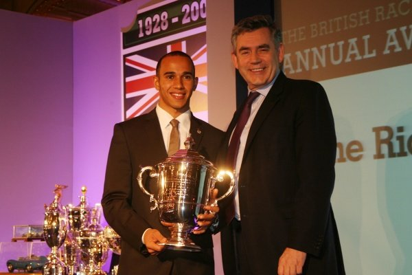 L-R: Lewis Hamilton (GBR) is presented with the Richard Seaman Trophy by Gordon Brown MP (GBR) Prime Minister of the United Kingdom. BRDC Annual Awards, The Cafe Royal, London, England, 8 December 2008.