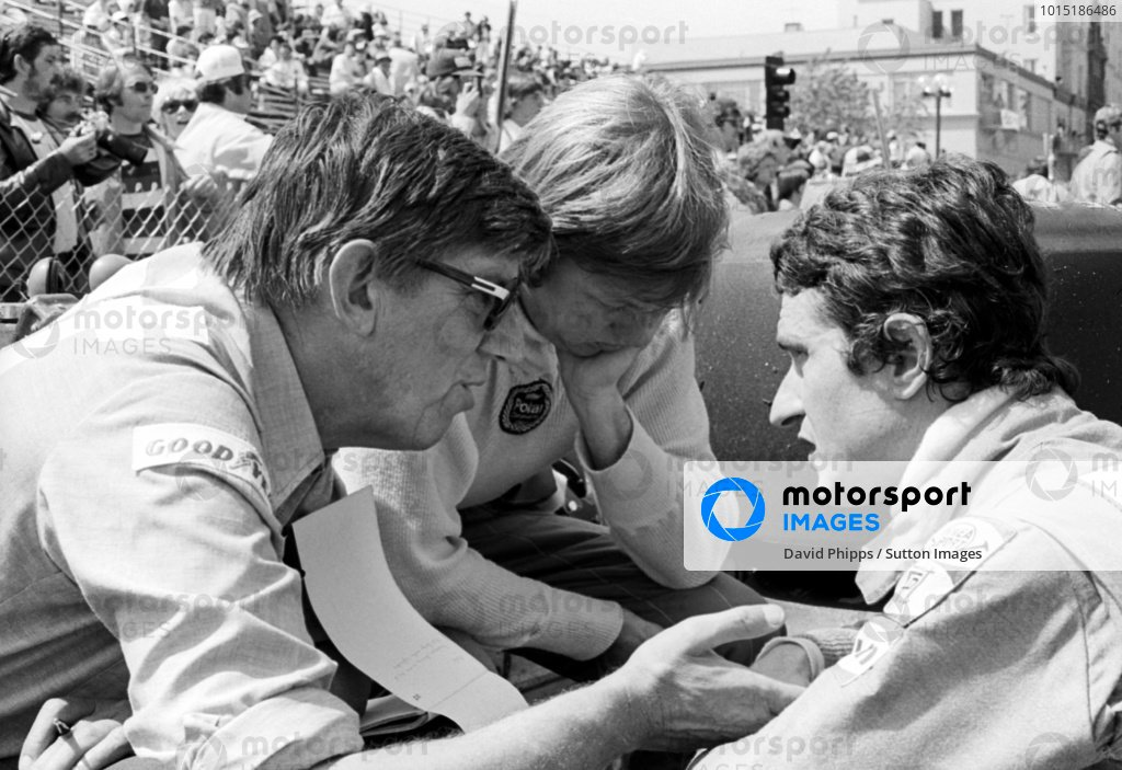 (L to R): Ken Tyrrell (GBR) Tyrrell Team Owner talks with Ronnie Peterson (SWE) Tyrrell, who retired from the race on lap 63 with a broken fuel line, and fourth placed Patrick Depailler (FRA) Tyrrell.United States Grand Prix (West), Rd 4, Long Beach, USA, 3 April 1977.
