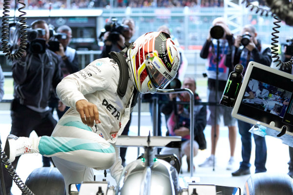 Silverstone, Northamptonshire, UK Friday 8 July 2016. Lewis Hamilton, Mercedes AMG, climbs in to his cockpit. World Copyright: Steve Etherington/LAT Photographic ref: Digital Image SNE10579