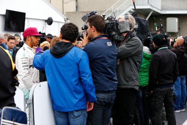 Circuit Gilles Villeneuve, Montreal, Canada. Saturday 11 June 2016. Pole man Lewis Hamilton, Mercedes AMG, speaks to the media. World Copyright: Andy Hone/LAT Photographic ref: Digital Image _ONZ0682