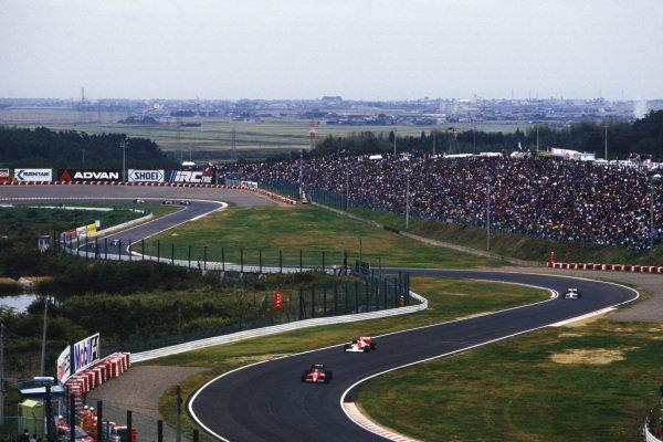 1987 Japanese Grand Prix Suzuka, Japan. 29th October - 1st November 1987.  Michele Alboreto, Ferrari F1-87, leads Stefan Johansson, McLaren MP4-3 TAG.  Ref: 87JAP02. World Copyright: LAT Photographic