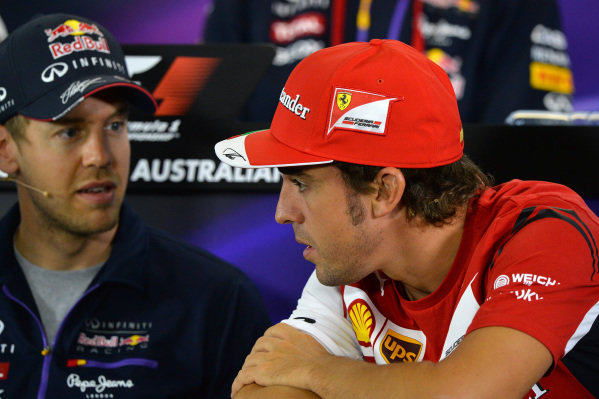 Sebastian Vettel (GER) Red Bull Racing and Fernando Alonso (ESP) Ferrari in the Press Conference. Formula One World Championship, Rd1, Australian Grand Prix, Preparations, Albert Park, Melbourne, Australia, Thursday 13 March 2014.
